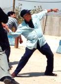 إدوارد وديع سعيد Edward_Said_thowing_a_stone_at_Israeli_soldiers