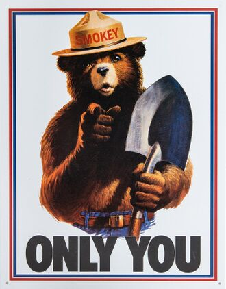 "Drawing of a grizzly bear with human features. He is wearing blue jeans with a belt and a brimmed hat with the name ""Smokey"" on the cap, and has a shovel in his left hand. He is pointing to the viewer while the text ""Only You"" is seen below him."