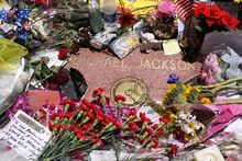 Recording artist Michael Jackson's Star, surrounded by flowers, candles, and cards, about two weeks after his death in 2009