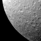 Impact craters on the surface of Rhea appear similar to Earth's Moon