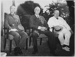 Three men, Chiang Kai-shek, Roosevelt and Churchill, sitting together elbow to elbow