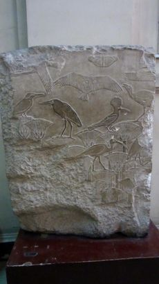 Fine relief showing birds and plants