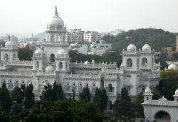 A white building with multiple domes