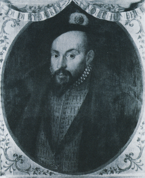 Miniature portrait of the Earl of Warwick, richly dressed in a slashed doublet with the Order of the Garter on a ribbon round his neck. He is a handsome man with dark eyes and dark goatee beard.