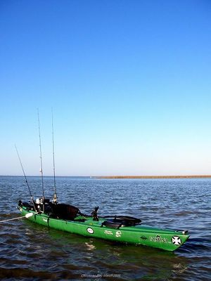 Photo of large two-person kayak with multiple fishing poles attached at stern