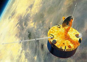 A stubby barrel-shaped spacecraft in orbit above Venus. A small dish antenna is at the centre of one of its end faces
