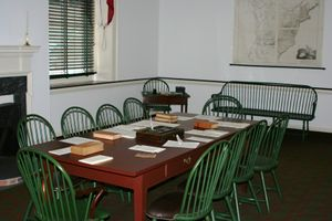 Photo of a table with chairs.
