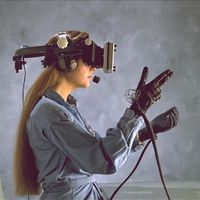 Head-mounted display and wired gloves, Ames Research Center.jpg