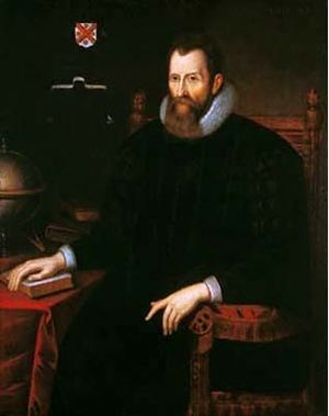 A baroque picture of a sitting man with a beard.
