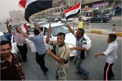تصغيراحتفالات العراق بانسحاب الجيش الأمريكي من البلاد